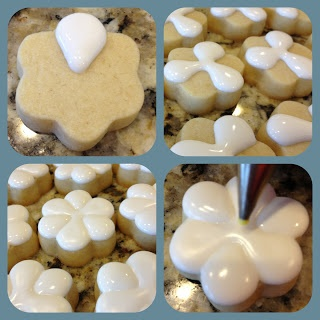 """Let them set for 5-10 again, or if you did a lot, the first one should be ready.  Take your second color and holding the tip straight over the center about 1/8"""" above the cookie, squeeze straight down until the center is big enough to """"separate"""" the petals.  The tip will eventually be """"in"""" the icing as you are squeezing - that's fine, don't move the tip and it will build a nice big puffy circle."""