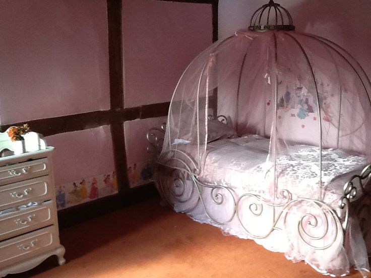You can get a glimpse of the dancing princess wallpaper border. The duvet cover is faux silk jacquard bought off ebay.