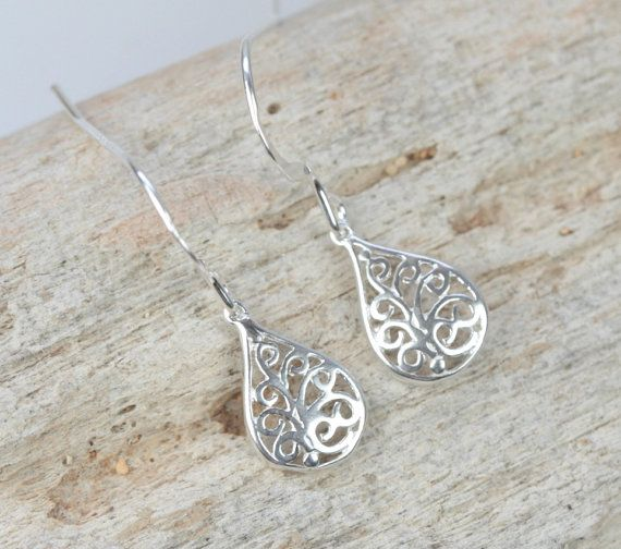 These earrings feature very small 11x8mm sterling silver filigree drops hung from sterling silver ear wires. These are very lightweight and petite