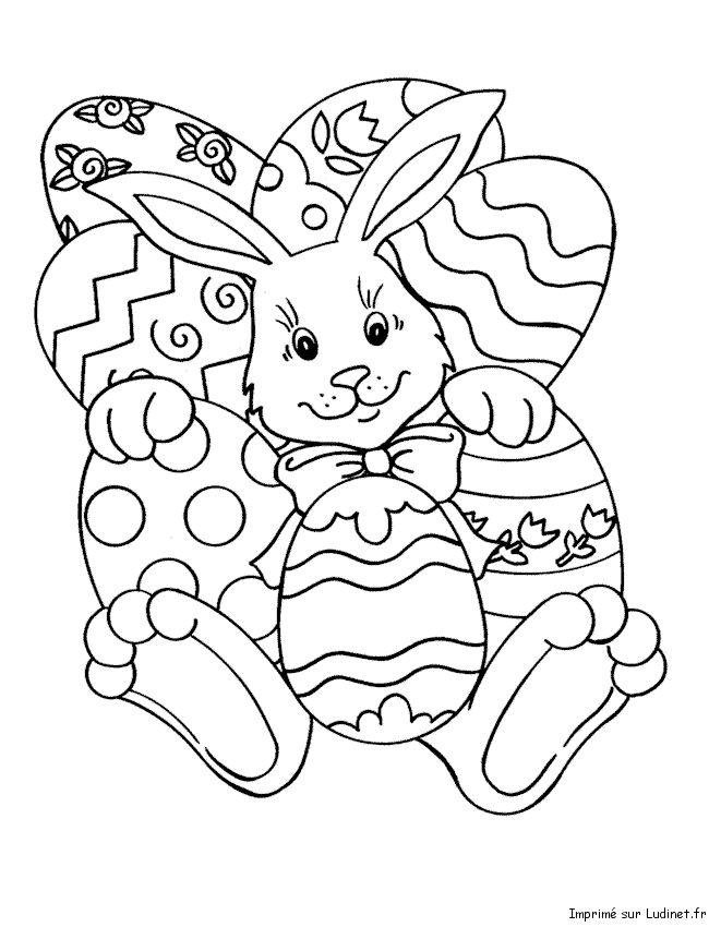 Coloriage d'un lapin couvert d'oeufs de pâques