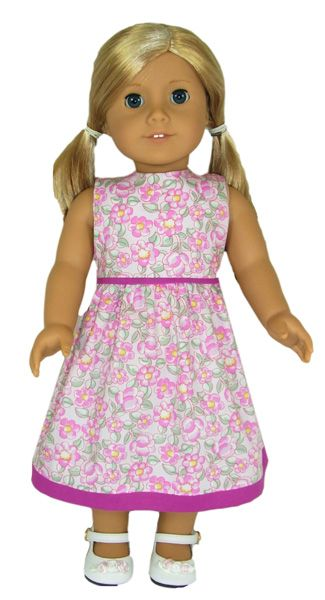 Summer Dress 18 Inch and American Girl Doll Clothes Patterns.  The contrasting trim on this Summer Dress turns a simple dress into a stylish dress. Add some pretty shoes and ribbons in your dolls hair and she is ready to go to that birthday party.  You get LIFETIME access to video instructions with Rosie showing you step-by-step how to create this wonderful outfit and downloadable PDF pattern pieces and instructions.