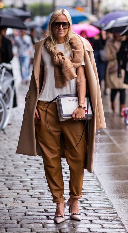A simple Tee, Cashmere, Leather sweatpants and Balenciaga handbag.