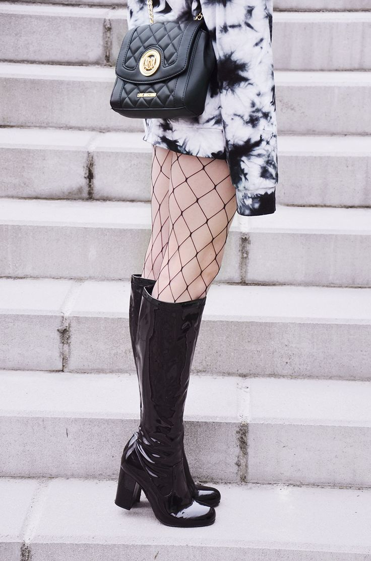 patent leather boots and fishnets with Love Moschino bag street style berlin