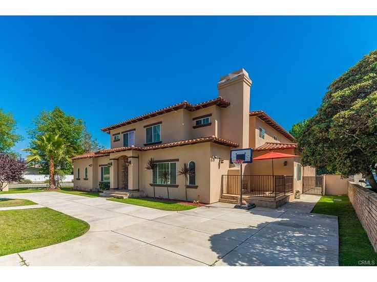LUXURY MEDITERRANEAN STYLE HOME IN PRIME EAST ARCADIA WITH AWARD WINNING SCHOOLS. YOU WILL FIND A PERFECT BLEND OF FORM AND FUNCTION. SITUATED ON A FLAT LOT WITH LANDSCAPED YARD AND ROOM FOR RV. THIS ELEGANT HOME FEATURES HIGH CEILINGS, CROWN MOLDINGS, SPECTACULAR CUSTOM INLAID FLOORS...ELEGANT ENTRANCE WITH HIGH CEILINGS LEADS TO GRACIOUSLY OVERSIZED LIVING ROOM AND FORMAL DINING ROOM, GOURMET KITCHEN WITH CENTER ISLAND, GRANITE COUNTER TOPS, STAINLESS STEEL REFRIGERATORS, OVERSIZED GARDEN…
