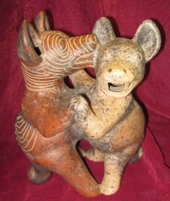 """Perros Peleandro"" Pre-Columbian Fighting Dogs. Reproduction of classical age (100-650 CE) terra cotta object  from Colima, Mexico. Made by Taller De Ceramica del Carmen for INAH, Mexico (National Institute of Anthropology and HIstory) 10.5"" tall. $65.00"