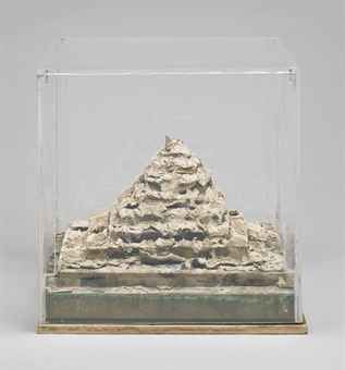 Dieter Roth (1930-1998) Into the Sea, Mold Mountain plaster, paper, chocolate, yogurt and fruit juice, mounted on metal in Plexiglas vitrine overall: 12 3/8 x 12 1/2 x 12 1/2 in. (31.4 x 31.7 x 31.7 cm.) Executed in 1969.  Edition of ten.