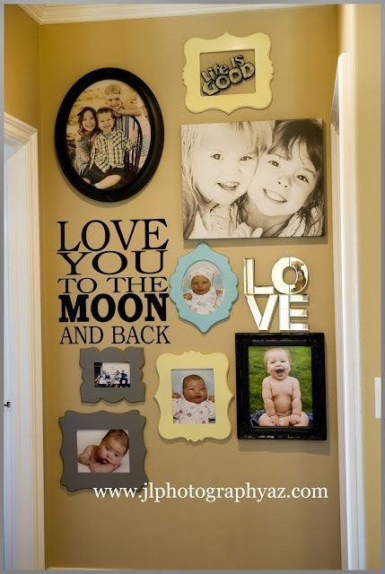 "LOVE this wall of framed pics arranged around the vinyl lettering ""Love You To the Moon & Back""."