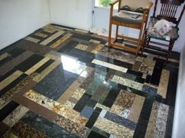 Floor made from free granite scraps. counter top installation companies throw the end pieces out all the time.