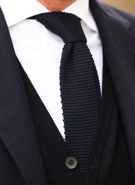 One of our favorite looks for knitted ties: Solid knit tie paired with cashmere cardigan.