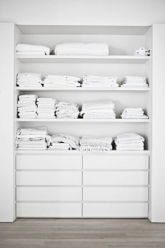 linen closet makeover by ikea...  it needs some sliding barn doors on it!