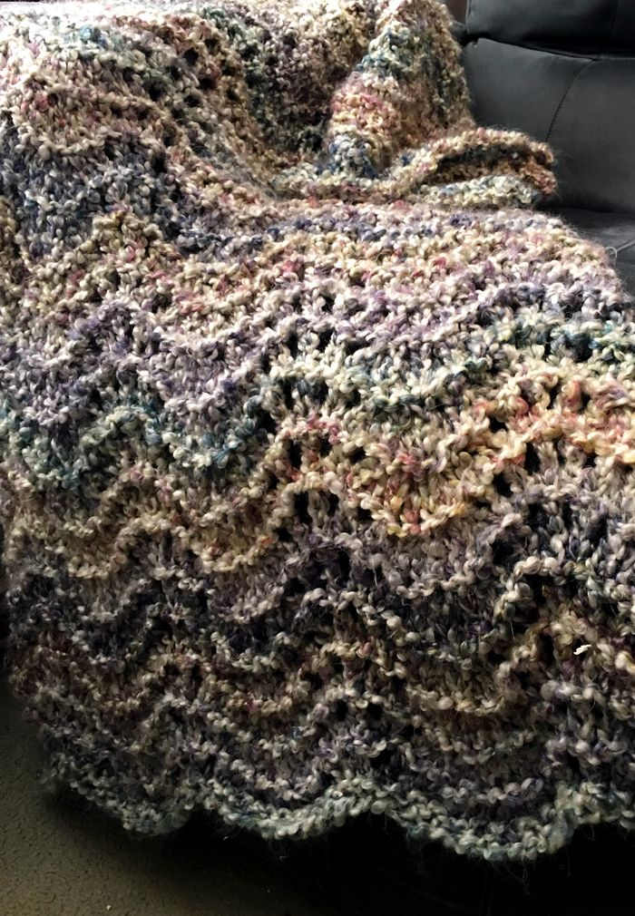 Free Knitting Pattern for 4 Row Repeat Rocking Waves Shawl or Baby Blanket - Easy 4 row repeat, 12 stitch lace pattern designed by Nancy J. Thomas for Red Heart. I adapted it for a lace shawl for my mother, though the original pattern is for a baby blanket. Pictured project by Terry Matz