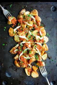 """Patatas Bravas is an addictive Spanish starter, but it's pretty heavy on the calories.. You'd never know this recipe was """"lightened up"""" when you try it!"""