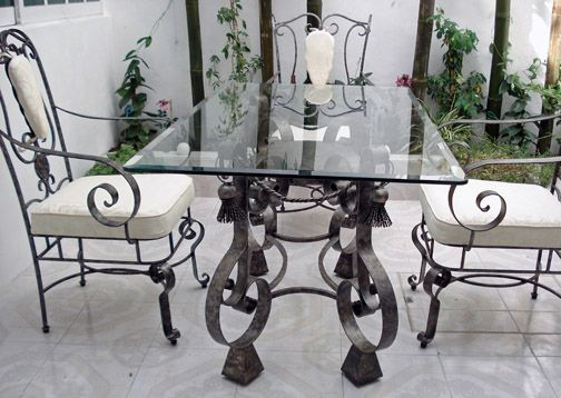 Mexican wrought iron furniture at its most exquisite. Love the swirls and tassles.