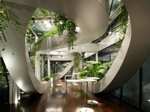 The Chamber of Commerce and Industry in Ljubljana, Slovenia designed by Sadar Vuga Architects stretch the possibilities of indoor gardens.