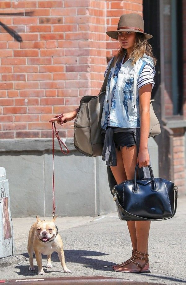 Chrissy Teign was spotted walking her dog in New York. The model paired together a bleached NSF vest with a pair of black denim shorts and a Current/Elliott shirt tied around her waist. She then ...