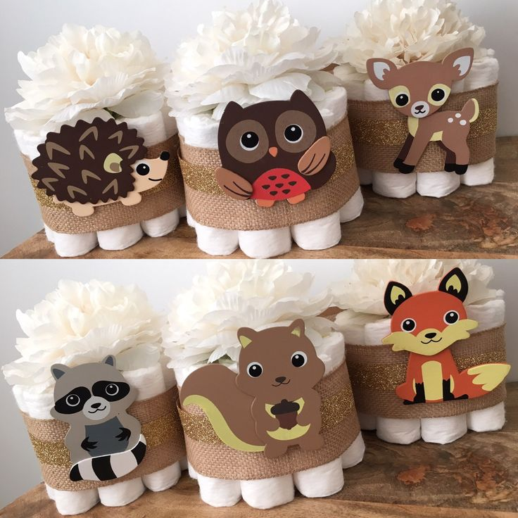 SET of 6 WOODLAND THEME MINI DIAPER CAKES with White Blossom Toppers . . . You will receive a set of 6 mini diaper cakes with various woodland animal wooden cutouts. 10 diapers per cake. They will be perfect centerpieces for you event! . . . At checkout, I will ask for your shower date so that all of my orders are managed appropriately and timely. If you select a date that is LESS THAN 10 DAYS at the time you purchase, it will be considered a Rush Order. See my Rush Order info here…