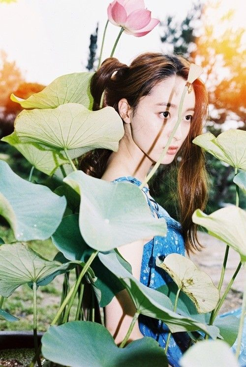 A girl stands among flowers in this photograph by Nina Ahn. More images here: http://www.dazeddigital.com/photography/article/20050/1/meet-the-next-generation-of-korean-photographers