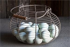 This Wire Egg Basket is the perfect addition to your farmhouse style decor. Collect eggs from the chicken coop or keep yarn tucked away. There are so many uses for this country classic.
