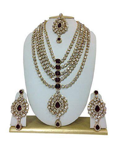 Indian Bollywood Style Gold Plated Maroon Stone Kundan Cz... https://www.amazon.ca/dp/B01LZWEGRX/ref=cm_sw_r_pi_dp_x_vFZHyb76AV9ZS