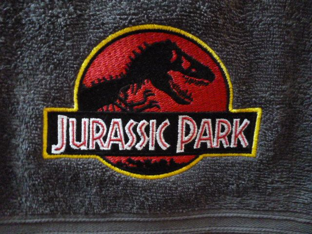 Embroidered Jurassic Park Bath towel. by Trufio on Etsy