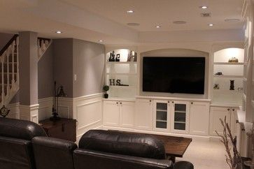 Basement Renovation - traditional - basement - toronto - Fine Design Living - like the way the brought light to the bookcases