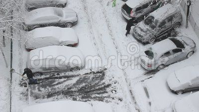 Car parking - people who clear snow from the cars.