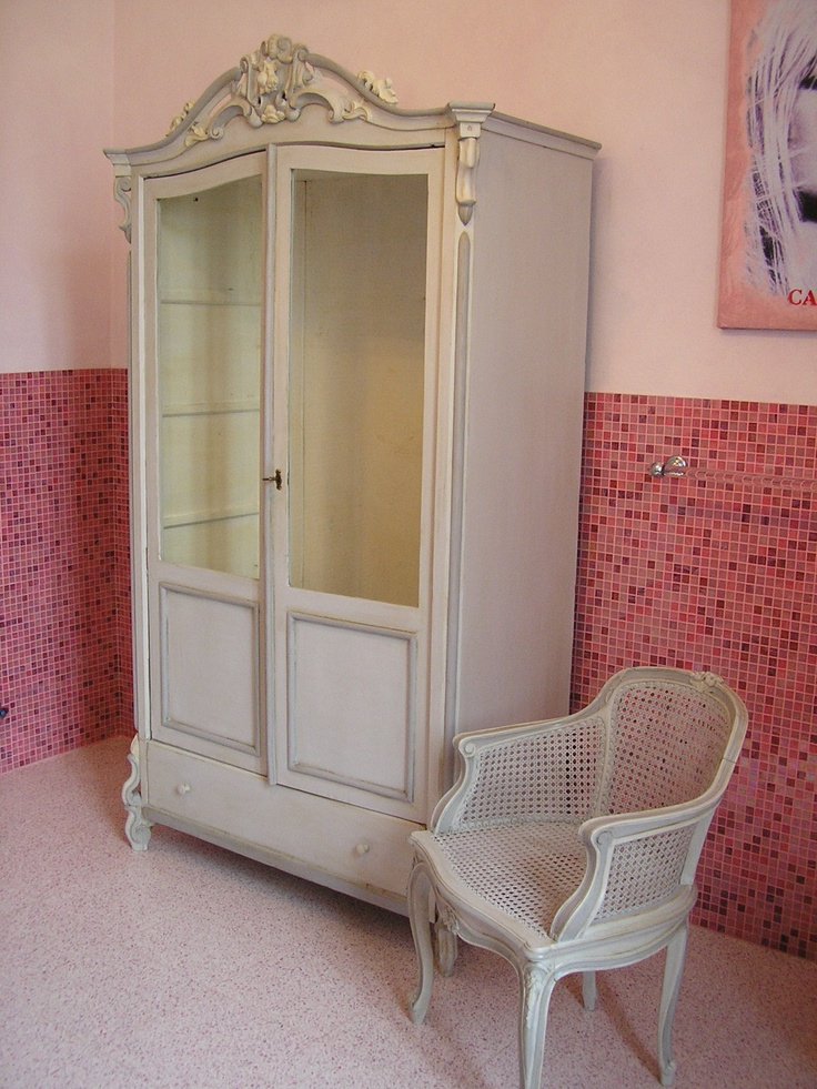Old french laquered wardrobe in beautiful salle de bain. With little chair