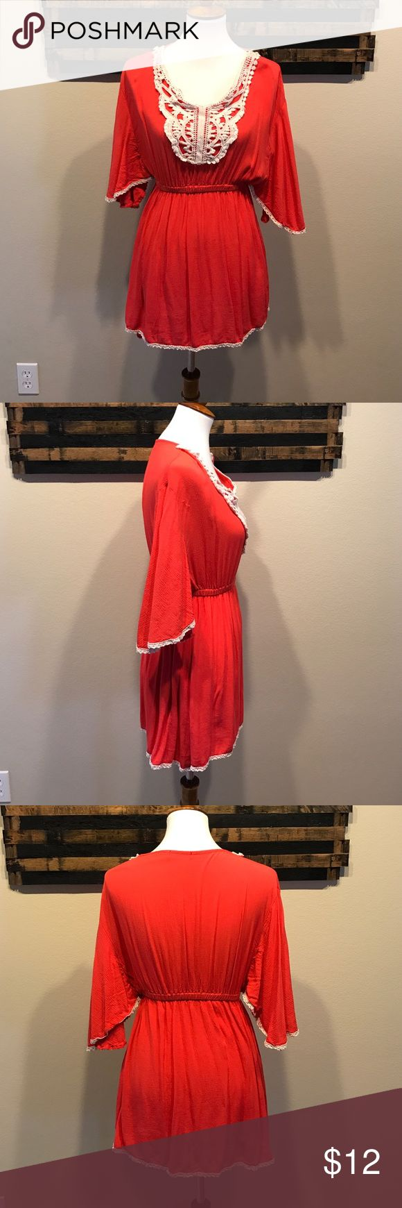 Coral swimsuit cover dress. Coral semi sheer swimsuit cover up. It's work like a dress with a waist band. It's got cream trim around the seams. It fits loose everywhere but the waist. Very breathable. Tag cut off for comfort. Swim Coverups