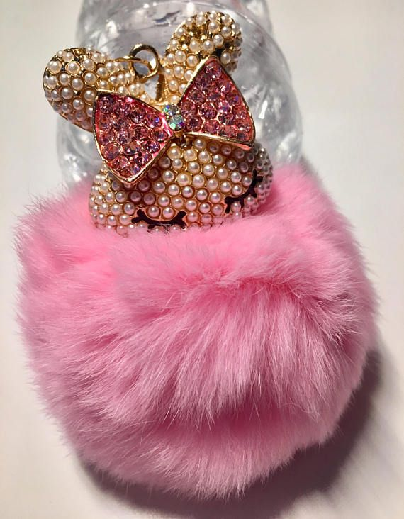 Fluffy Pink PomPom with a Bling Bunny! ~ Key Ring / Bag Charm / Car Mirror Charm. Features a fake fur pink PomPom with a bling Bunny Charm attached. The PomPom measures Approx 6cm diameter. This can be attached to your Keys / Bag / Car Mirror. If you require it for your Car