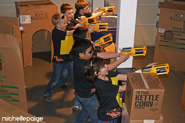 Nerf war party. My sons would love this. I'm sure I will have done this at least once before my boys are grown...and maybe still after they are grown. Her shirts are great!