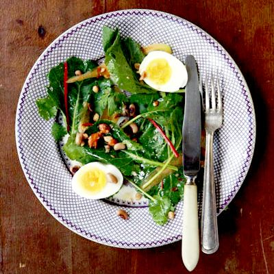 From a collection of winter salads - actually ALL the winter salads you could hope for!  Collard Greens Salad with Peanut Vinaigrette  Recipe - Saveur.com