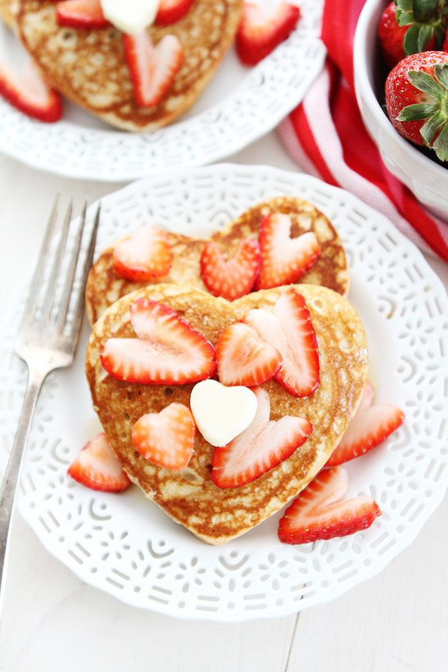 Heart Pancakes Recipe on twopeasandtheirpod.com These simple heart shaped pancakes are perfect for Valentine's Day!