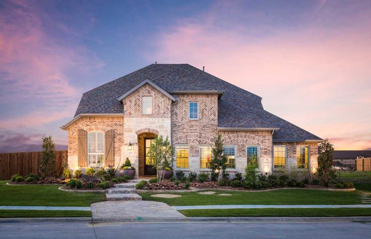Stately Brick And Stone Highlight A Gorgeous Two story