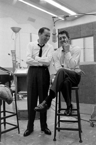 Frank Sinatra and Dean Martin share a light moment during their recording