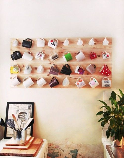 This is a cute idea, it could be mugs you collect when you travel or novelty mugs that you and your loved ones pick out. It will look neat on the wall in a kitchen and also provide some good memories.