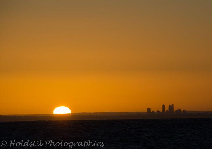 Nikon D5100 Auto mode No flash. 1/1000 sec exposure f/8 focal length 140mm ISO 160 (auto) Lens 55-300mm. Sunrise Perth Skyline