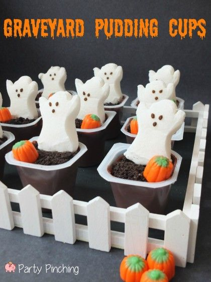 Pudding cups topped with crushed oreos, a peeps ghost, and candy pumpkin to finish the look!