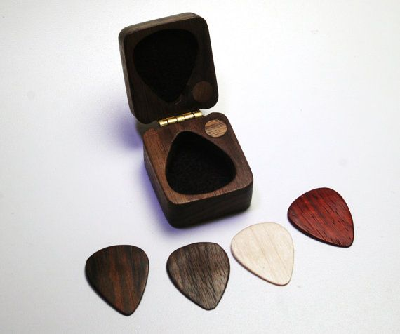 Black walnut box and guitar pick set. Solid hardwood, magnetic latch system, felt lined, brass hinge. 4 wood pick set - left to right - Cocobolo, Black Walnut, Maple, Paduak wood. Perfect gift for your favorite musician or anyone who loves beautiful wood & a wonderful tone. International shipping welcome.  This unique guitar pick box was created from the finest quality hard wood that money can buy... Sanded to a smooth luxurious finish and finished with the highest quality details like it...