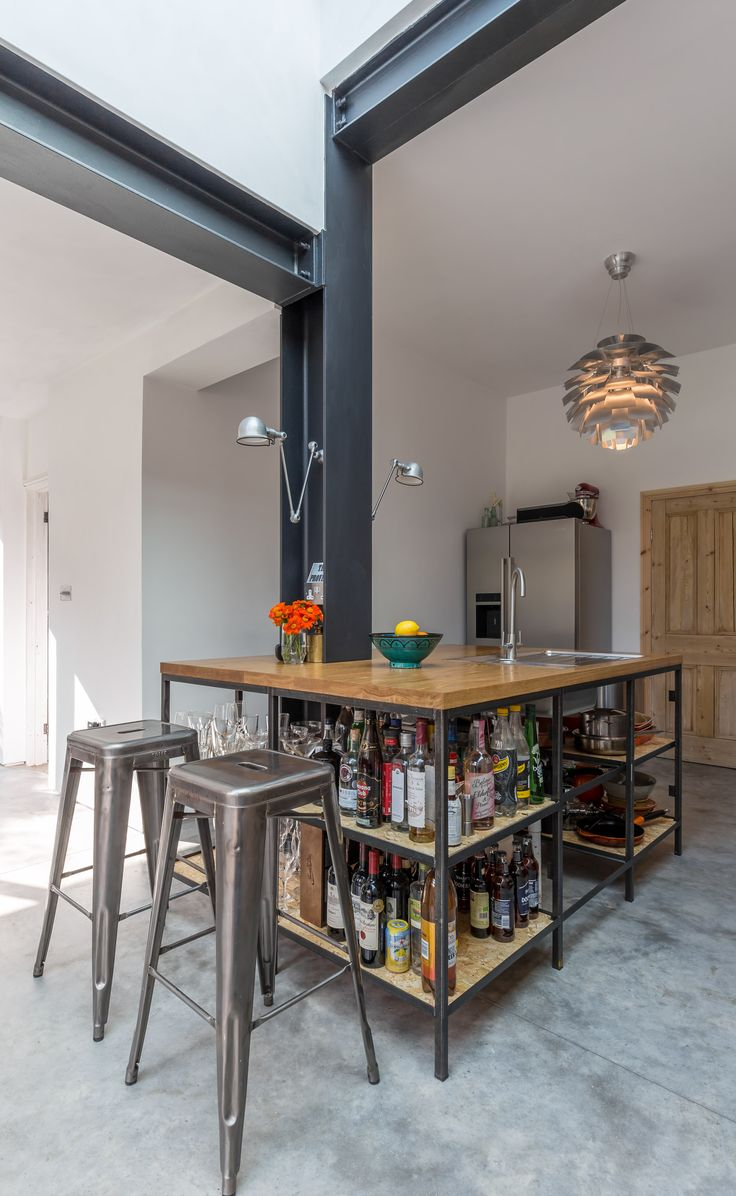 Modern style industrial kitchen | open shelving | exposed structure | steel beams | kitchen island table | bar stools |