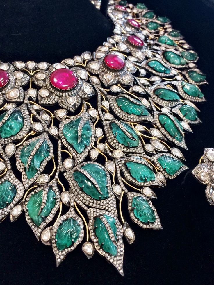 Zambian emerald, Mozambican ruby and diamond necklace set in 18k white and yellow gold.