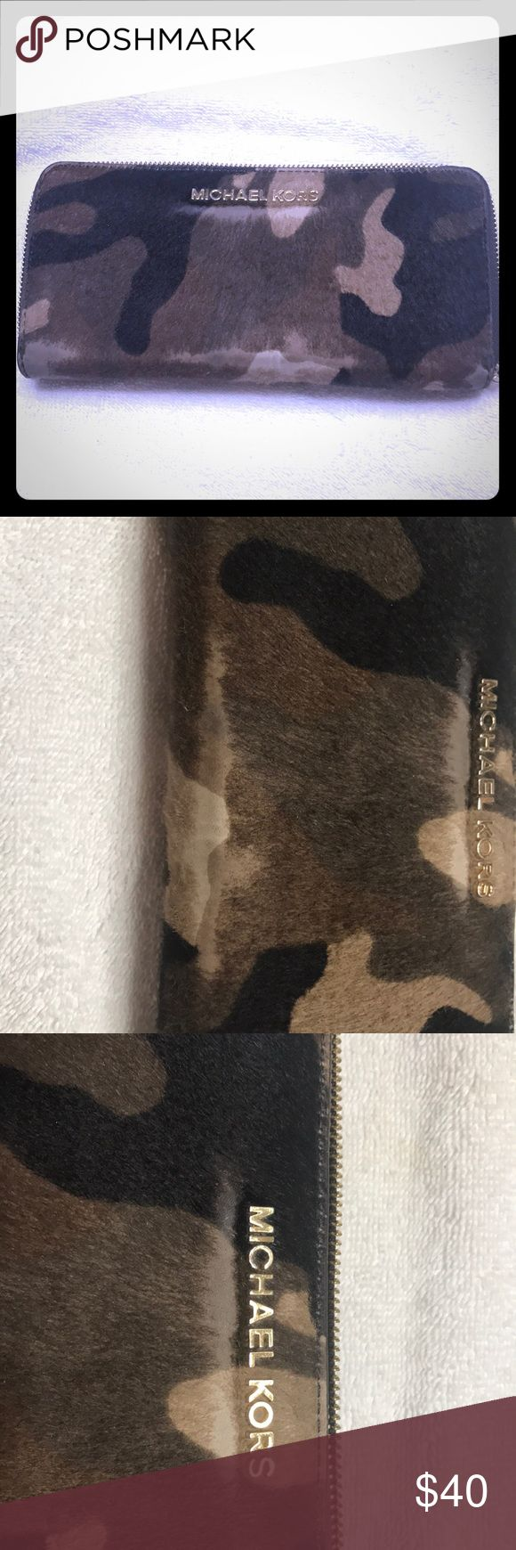 Michael Kors pint hair camo wallet Pre owned Michael Kors pint hair camo print wallet.  Photos show condition. Michael Kors Bags Wallets