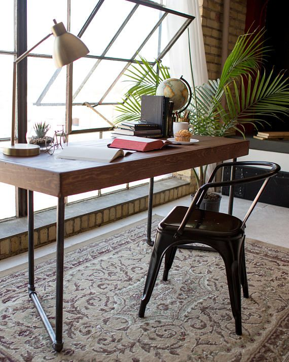 Genesis Wood - solid wood desk, pipe legs But seriously, that setting would make anything look good! I want that office.