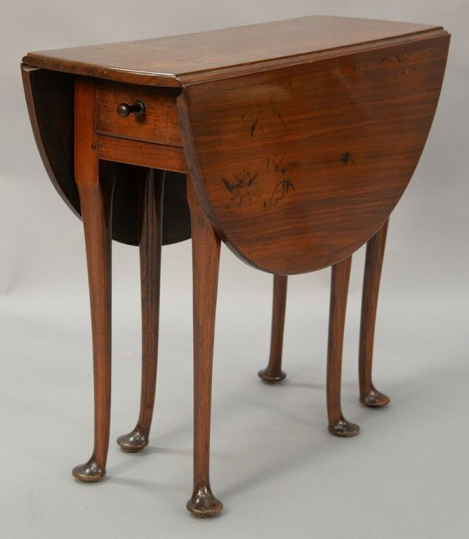 Queen Anne diminutive drop leaf walnut table having oval drop leaves with drawer, set on six turned legs ending in pad feet, circa 1750 ~ realized price $6,250.00  #nadeausauction