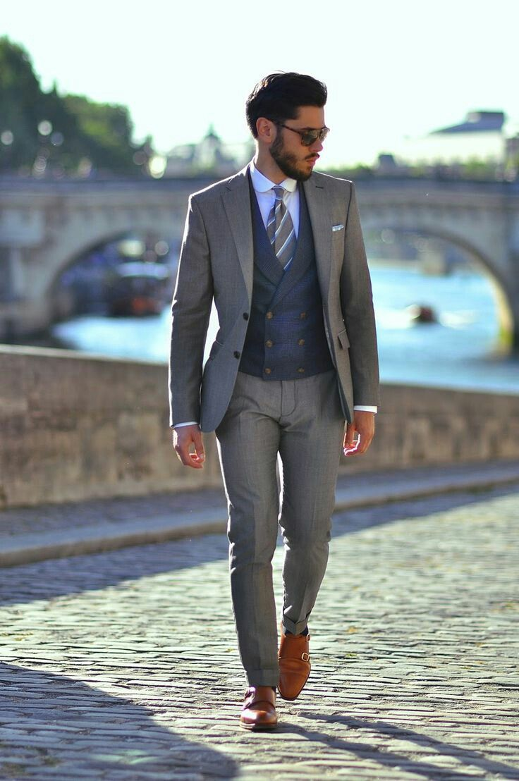 What a great combination. The colors work perfectly together (Grey & blue always work as long as they are clearly different shades). Also love the double breasted vest combined with modern cut suit. (Only thing i dislike is the rounded shirt collar....