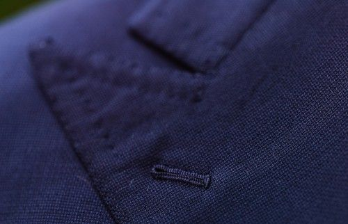 The hopsack fabric with a special seam along the edge of the lapel, with a button-hole for a boutonniere.