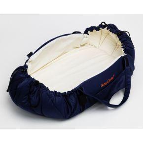 SleepCarrier är en unik barnprodukt framtagen för att underlätta för barns sömn. Den är en horisontell bärsele, en mjuklift, ett babynest och en madrass. SleepCarrier rekommenderas av barnpsykologer för de verktyg föräldern får för att ge en trygg anknytning till sitt barn. Som mjuklift är SleepCarrier tillräckligt liten för att få plats i de flesta liggkorgar.  Najell - SleepCarrier Swedish Baby Carry Cot - Harness.