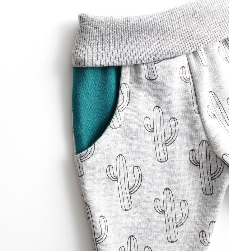 These buttery soft sweatpants are made from premium vibrant cotton for comfort and warmth during cold winter days. They offer a comfortable stretch with a slim fit for your little one.  The trendy turquoise pockets and cactus print are gender neutral for a boy or girl.