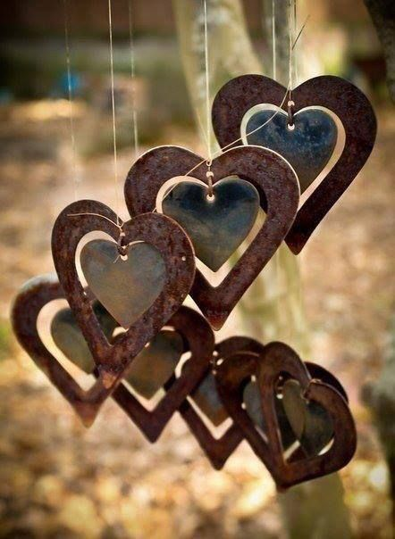 That moment you see something on Pinterest you already have. Rustic metal outdoor heart chimes .
