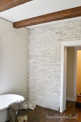 how to white wash brick: in a glass measuring cup, mix 2 cups water with 2 cups paint. paint the brick with the mixture (2 coats). be sure to put down a drop cloth because it can get really messy!
