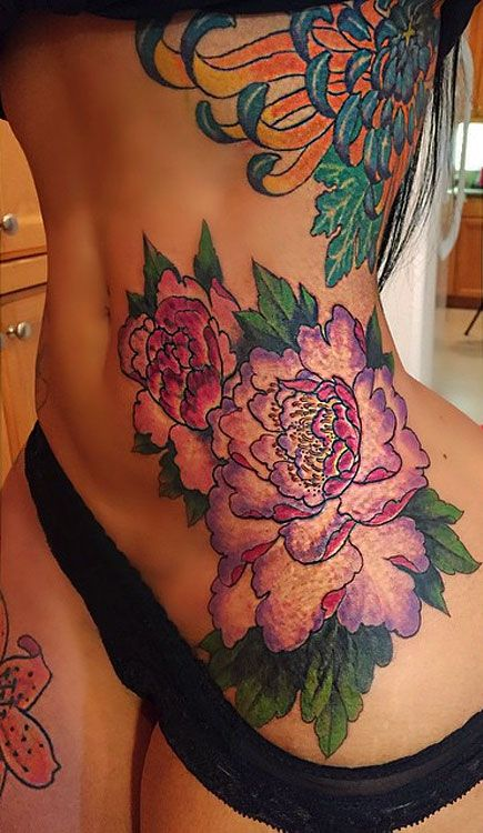 blac-chyna-tattoo-hip-flowers